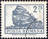 "ROMANIA - CIRCA 1972: A stamp printed in Romania from the ""Definitives I - Buildings"" shows Sphinx Rock, Mt. Bucegi, circa 1972. — ストック写真"