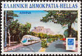 """GREECE - CIRCA 2004: A stamp printed in Greece from the """"Cities hosting Olympic events"""" issue shows Athens (a tram and Acropolis), circa 2004. — Stock Photo"""