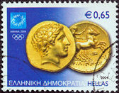 """GREECE - CIRCA 2004: A stamp printed in Greece from the """"Athens Olympic games 2004: Ancient coins"""" issue shows a Gold Stater of Philip II of Macedonia, circa 2004. — Stock Photo"""