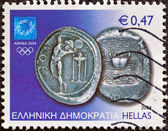 """GREECE - CIRCA 2004: A stamp printed in Greece from the """"Athens Olympic games 2004: Ancient coins"""" issue shows a silver 3-drachma coin of Cos island, circa 2004. — Stock Photo"""