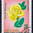 "VIETNAM - CIRCA 1968: A stamp printed in North Vietnam from the ""Flowers"" issue shows a yellow rose, circa 1968. — Stock Photo"