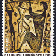 "GREECE - CIRCA 1983: A stamp printed in Greece from the ""Homeric epics"" issue shows Odysseus blinding Polyphemus, circa 1983. - Stock Photo"