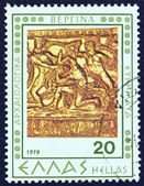 "GREECE - CIRCA 1979: A stamp printed in Greece from the ""Vergina archaeological findings"" issue shows part of a sculpted golden arrow and bow case, circa 1979. — Stock Photo"