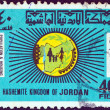 jordan - circa 1979: a stamp printed in jordan issued for the 1979 population and housing census shows map of jordan and a family, circa 1979. — Stock Photo