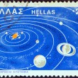 GREECE - CIRCA 1980: A stamp printed in Greece issued for the 2300th birth anniversary of ancient Greek astronomer Aristarchus of Samos, shows Heliocentric system, circa 1980. — Stock Photo