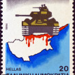 GREECE - CIRCA 1984: A stamp printed in Greece issued for 10th anniversary of Turkish invasion of Cyprus shows a tank on a map of Cyprus, circa 1984. — Stock Photo #16503455