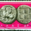 "GREECE - CIRCA 1963: A stamp printed in Greece from the ""Ancient Greek Coins"" issue shows a coin from Abdera, Thrace 5th century B.C. (Griffin and squares), circa 1963. - Stock Photo"