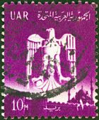 EGYPT - CIRCA 1961: A stamp printed in Egypt shows the Eagle of Saladin and Cairo Citadel, circa 1961. — Stock Photo