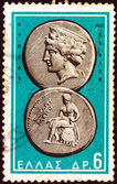 """GREECE - CIRCA 1963: A stamp printed in Greece from the """"Ancient Greek Coins"""" issue shows a coin from Paphos, Cyprus 4th century B.C. (Aphrodite and Apollo), circa 1963. — Stock Photo"""