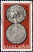 """GREECE - CIRCA 1963: A stamp printed in Greece from the """"Ancient Greek Coins"""" issue shows a coin from Crete 3rd century B.C. (Apollo and labyrinth), circa 1963. — Stock Photo"""