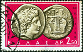 "GREECE - CIRCA 1963: A stamp printed in Greece from the ""Ancient Greek Coins"" issue shows a coin from Chalcidice, Macedonia 4th century B.C. (Apollo and lyre), circa 1963. — Stock Photo"