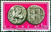 """GREECE - CIRCA 1963: A stamp printed in Greece from the """"Ancient Greek Coins"""" issue shows a coin from Abdera, Thrace 5th century B.C. (Griffin and squares), circa 1963. — Stock Photo"""