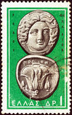 """GREECE - CIRCA 1963: A stamp printed in Greece from the """"Ancient Greek Coins"""" issue shows a coin from Rhodes 4th century B.C. (Helios and rose), circa 1963. — Stock Photo"""