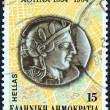 GREECE - CIRCA 1984: A stamp printed in Greece issued for the 150th Anniversary of Athens as Capital, shows an Athens 5th century B.C. silver coin on plan of the city, circa 1984. — Stock Photo