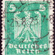 GERMANY - CIRCA 1924: A stamp printed in Germany shows the Eagle, coat of arms of Germany, circa 1924. — Stock Photo