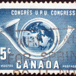 Stock Photo: CANAD- CIRC1957: stamp printed in Canadissued for 14th UPU Congress, Ottawshows Globe within posthorn, circ1957.
