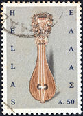 "GREECE - CIRCA 1966: A stamp printed in Greece from the ""Greek Popular Art"" issue shows a Cretan lyre, circa 1966. — Stock Photo"