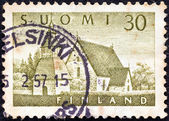 FINLAND - CIRCA 1956: A stamp printed in Finland shows Lammi Church, circa 1956. — Стоковое фото