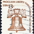 "Stock Photo: US- CIRC1975: stamp printed in USfrom ""Americana"" issue shows Liberty Bell and inscription ""Proclaim Liberty Throughout All Land"", circ1975."