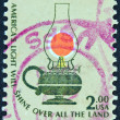 "Stock Photo: US- CIRC1975: stamp printed in USfrom ""Americana"" issue shows kerosene table lamp and inscription ""America's Light Will Shine Over All Land"", circ1975."