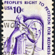 "Stock Photo: US- CIRC1975: stamp printed in USfrom ""Americana"" issue shows Contemplation of Justice statue (J. E. Fraser) and inscription ""'s Right to Petition for Redress"", circ1975."