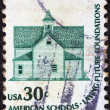 "Stock Photo: US- CIRC1975: stamp printed in USfrom ""Americana"" issue shows Morris Township School, Devils Lake, and inscription ""AmericSchools-Laying Future Foundations"", circ1975"