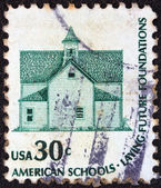 """USA - CIRCA 1975: A stamp printed in USA from the """"Americana"""" issue shows the Morris Township School, Devils Lake, and the inscription """"American Schools-Laying Future Foundations"""", circa 1975 — Stock Photo"""