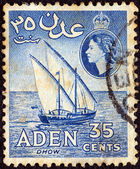 ADEN COLONY - CIRCA 1953: A stamp printed in United Kingdom shows a dhow and Queen Elizabeth II, circa 1953. — Stock Photo