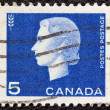 CANADA - CIRCA 1962: A stamp printed in Canada shows a portrait of Queen Elizabeth II and Agriculture symbol, circa 1962. — Stock Photo