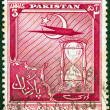 PAKISTAN - CIRC1951: stamp printed in Pakistissued for 4th anniversary of Independence shows airplane and hourglass, circ1951. — Stock Photo #18792031