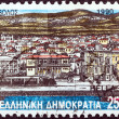 "GREECE - CIRCA 1990: A stamp printed in Greece from the ""Prefecture Capitals (2nd series)"" issue shows City and Town Hall (woodcut, A. Tassos), Volos, Magnesia, circa 1990. — Stock Photo"