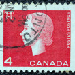 CANADA - CIRCA 1962: A stamp printed in Canada shows a portrait of Queen Elizabeth II and Electricity pylon symbol, circa 1962. — Stock Photo