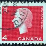 CANADA - CIRCA 1962: A stamp printed in Canada shows a portrait of Queen Elizabeth II and Electricity pylon symbol, circa 1962. — Stock Photo