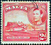 MALTA - CIRCA 1938: A stamp printed in Malta shows Victoria and Citadel, Gozo and King George VI, circa 1938. — Stock Photo
