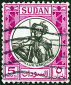 Sudan - intorno al 1951: un timbro stampato in sudan illustrato guerriero shilluk, intorno al 1951. — Foto Stock