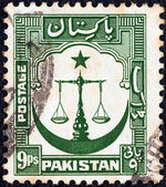 PAKISTAN - CIRCA 1948: A stamp printed in Pakistan shows Scales of Justice with crescent moon, circa 1948. — Stock Photo