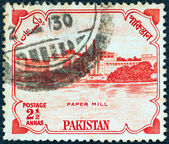 PAKISTAN - CIRCA 1955: A stamp printed in Pakistan issued for the 8th anniversary of Independence shows Karnaphuli Paper Mill, East Bengal, circa 1955. — Stock Photo