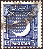 PAKISTAN - CIRCA 1949: A stamp printed in Pakistan shows Star and Crescent Moon, circa 1949. — Stock Photo
