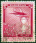 PAKISTAN - CIRCA 1951: A stamp printed in Pakistan issued for the 4th anniversary of Independence shows airplane and hourglass, circa 1951. — Stock Photo