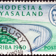 RHODESIA AND NYASALAND - CIRCA 1960: A stamp printed in Rhodesia from the &quot;Opening of Kariba Hydroelectric Scheme&quot; issue shows Barrage wall and Queen Elizabeth II, circa 1960. - Stock Photo