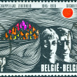 BELGIUM - CIRCA 1970: A stamp printed in Belgium issued for the 25th anniversary of Belgian Social Security shows man, woman and hillside town, circa 1970. - Stock Photo