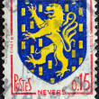 "Stock Photo: FRANCE - CIRC1962: stamp printed in France from ""Arms of French Towns 4th Series"" issue shows Nevers coat of arms, circ1962."