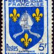 "Stock Photo: FRANCE - CIRC1954: stamp printed in France from ""Arms of Provinces 7th Series"" issue shows Saintogne coat of arms, circ1954."