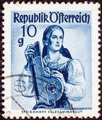 "AUSTRIA - CIRCA 1948: A stamp printed in Austria from the ""Provincial Costumes"" issue shows a woman from Steiermark Salzkammergut, circa 1948. — Stock Photo"