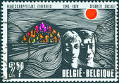 BELGIUM - CIRCA 1970: A stamp printed in Belgium issued for the 25th anniversary of Belgian Social Security shows man, woman and hillside town, circa 1970. — Stock Photo