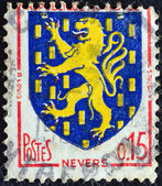 """FRANCE - CIRCA 1962: A stamp printed in France from the """"Arms of French Towns 4th Series"""" issue shows Nevers coat of arms, circa 1962. — Stock Photo"""