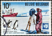 "BELGIUM - CIRCA 1971: A stamp printed in Belgium issued for the 10th anniversary of Antarctic treaty shows scientist, Adelie penguins and polar vessel ""Erika Dan"", circa 1971. — Stock Photo"