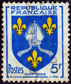 "FRANCE - CIRCA 1954: A stamp printed in France from the ""Arms of Provinces 7th Series"" issue shows Saintogne coat of arms, circa 1954. — Stock Photo"