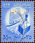 EGYPT - CIRCA 1958: A stamp printed in Egypt shows ship and crate on hoist and Egypt emblem, circa 1958. — Stock Photo