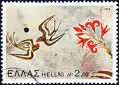 "GREECE - CIRCA 1973: A stamp printed in Greece from the ""Archaeological Discoveries, Island of Thera"" issue shows Swallows and flowers, circa 1973. — Stock Photo"